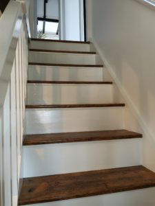 Staircase including treads sanded down and repainted and varnished in West Runton.
